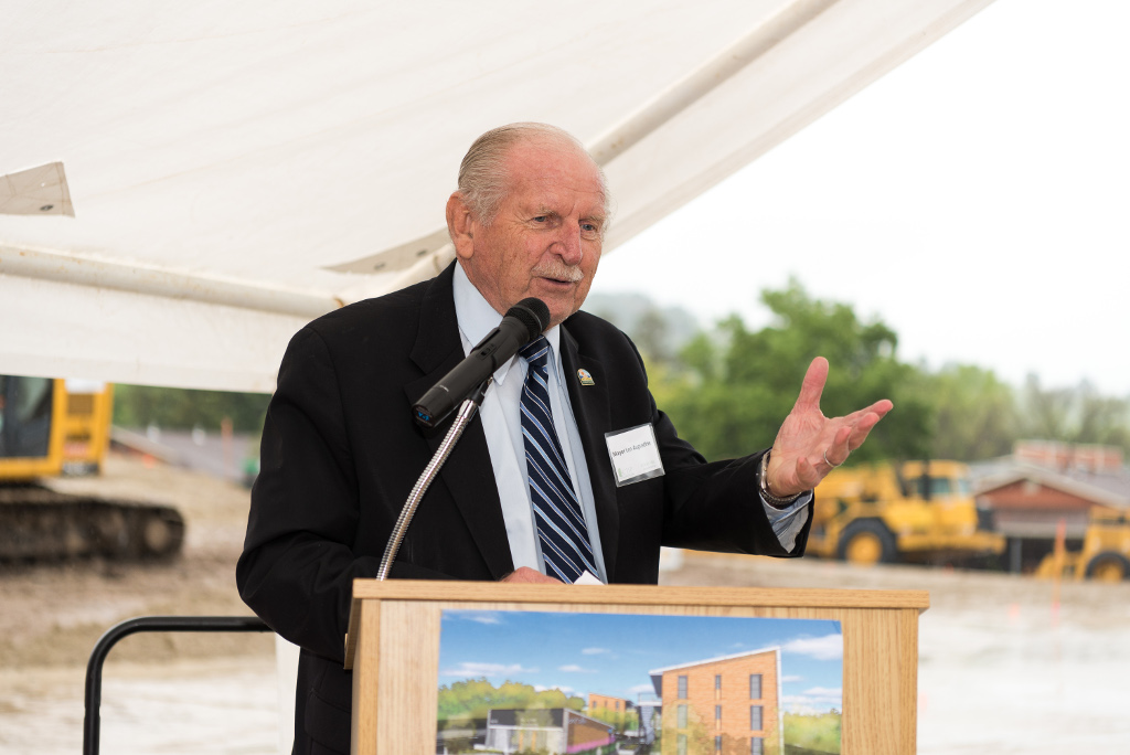 An older man speaking at a podium outside at the Rocky Hill Groundbreaking Ceremony