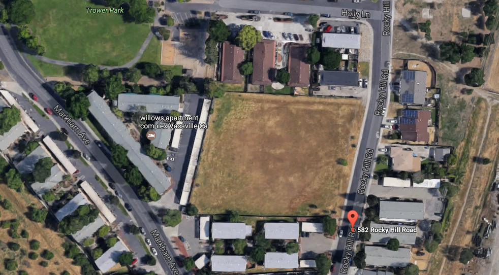 An arial photo with an empty field in the center, showing where the Rocky Hill Veterans Housing project will be located.