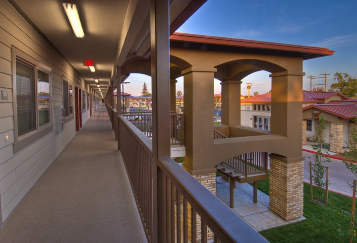 Second story walkway and stairs at Boulevard Court Apartments
