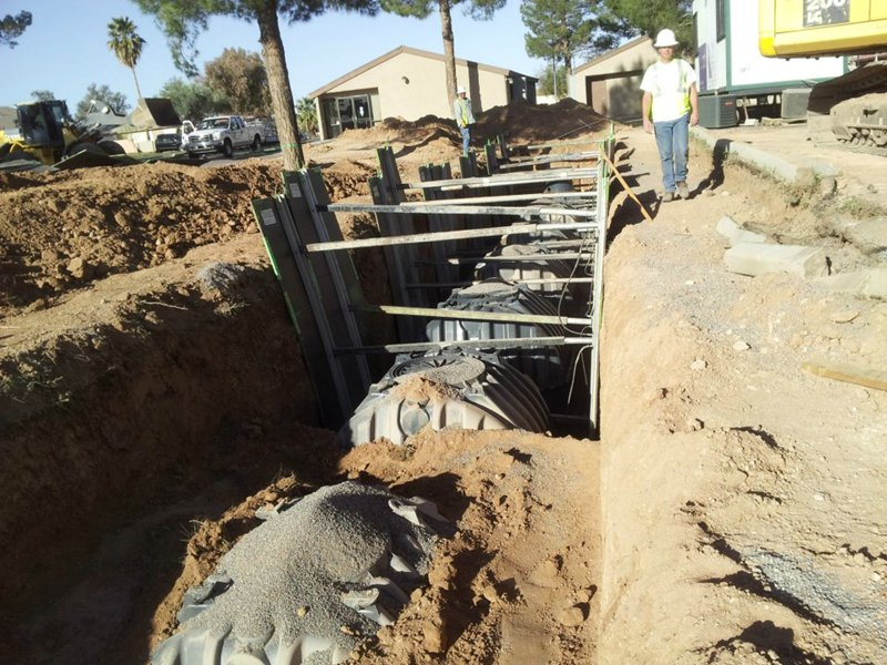 Half-burried water tanks at Kachina Apartments