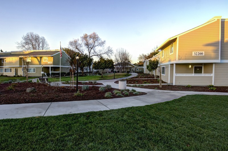 Grass, walkway and buildings at Los Robles