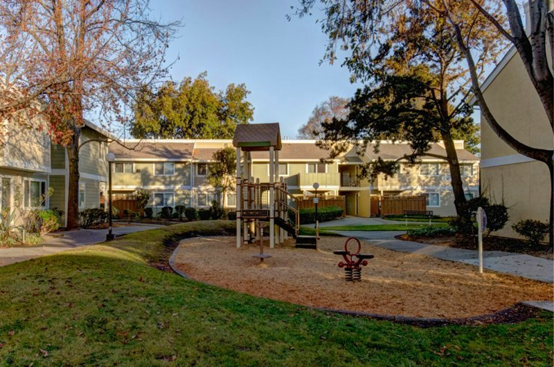 Play area, walkway and apartments at Los Robles