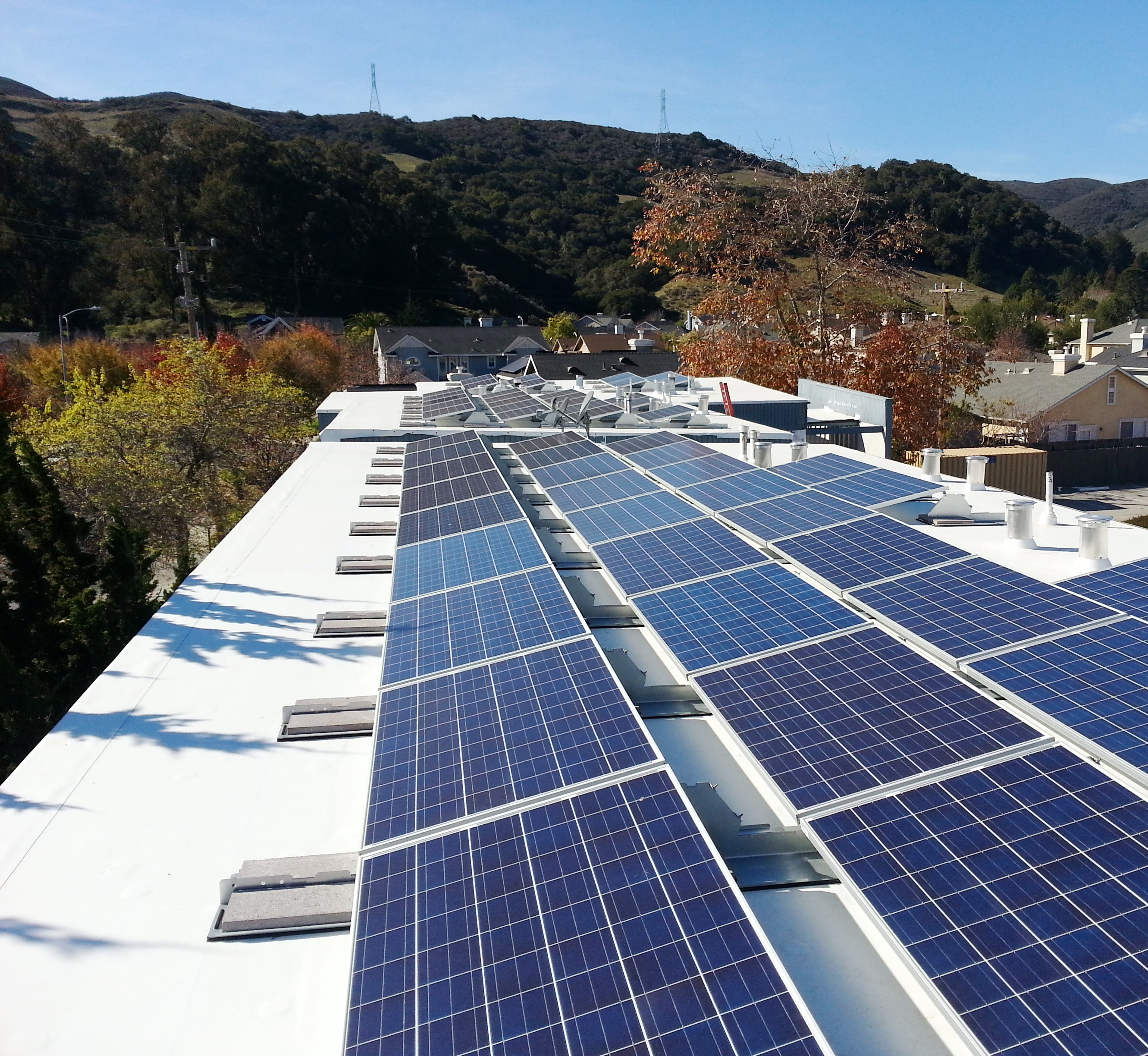 Solar panels on the roof of Madonna Road Apartments