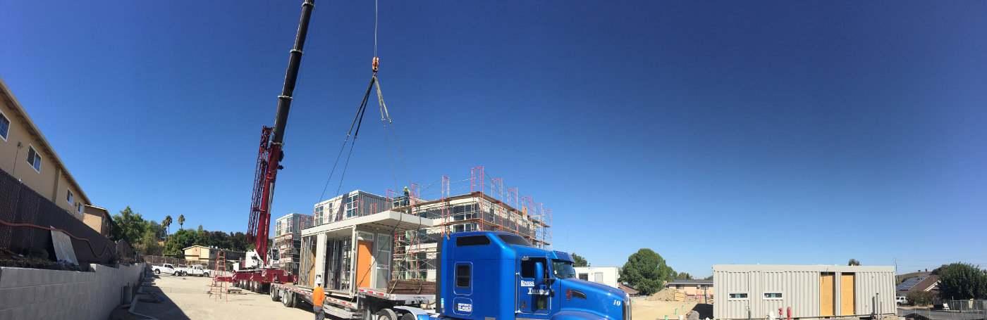 Modified shipping containers are delivered at Rocky Hill Veterans Housing construction site