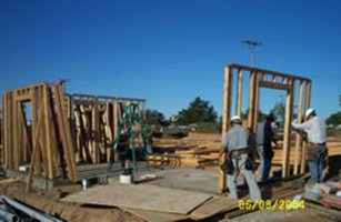 Two construction workers raising wood framing at Sunnyslope Apartments
